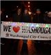 People Holding a We Love Washougal Banner in the Christmas Parade
