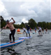 A Group Racing on Paddleboards