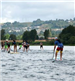 The Back of a Group Racing on Paddleboards