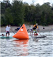 People Participating in a Paddleboard Race