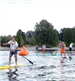 Group of Men Racing on Paddleboards
